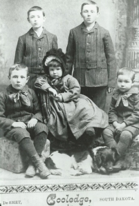 The adorable Masters children and their dog (name unknown). Standing (left to right) Alex and Arthur Masters; sitting (left to right) Vere, Nita, and Claude Masters. From the photo collection of Lucille (Masters) Mone. Used with permission.